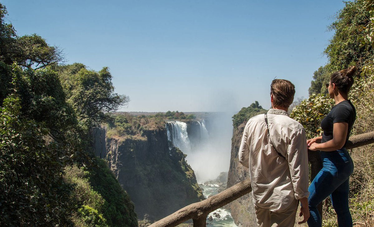Couple looking at Victoria Falls from viewpoint