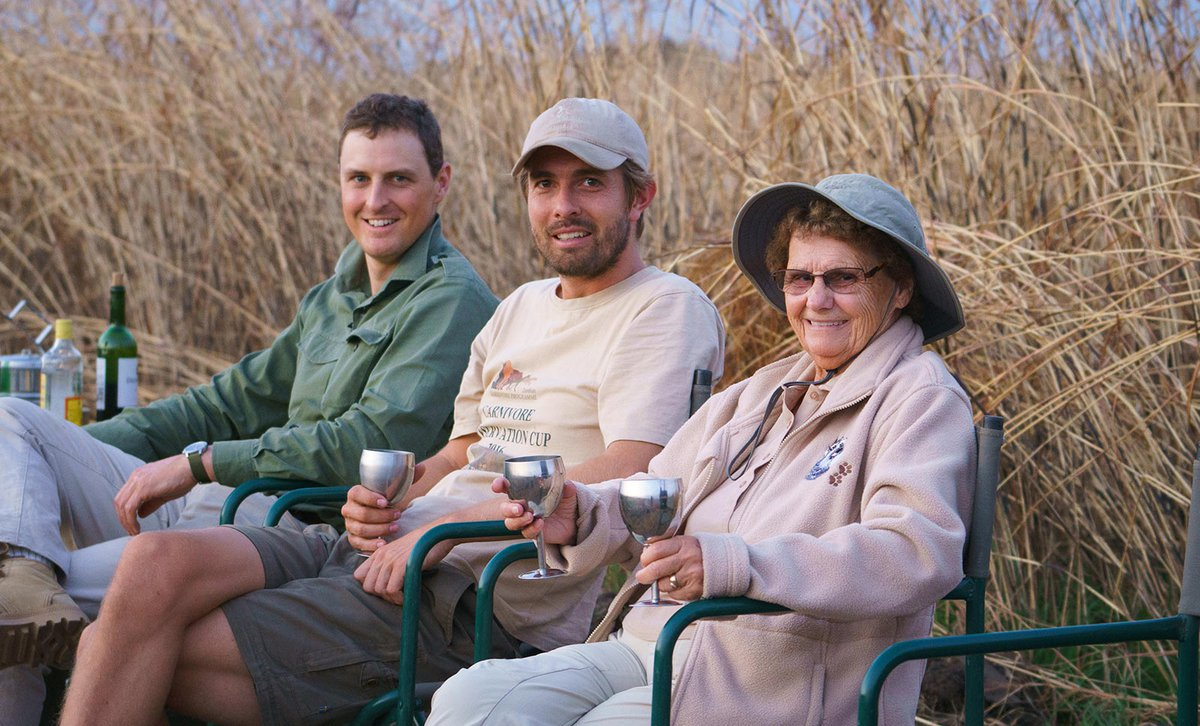 Africa Exclusive client Sharon and family enjoying sundowners on safari