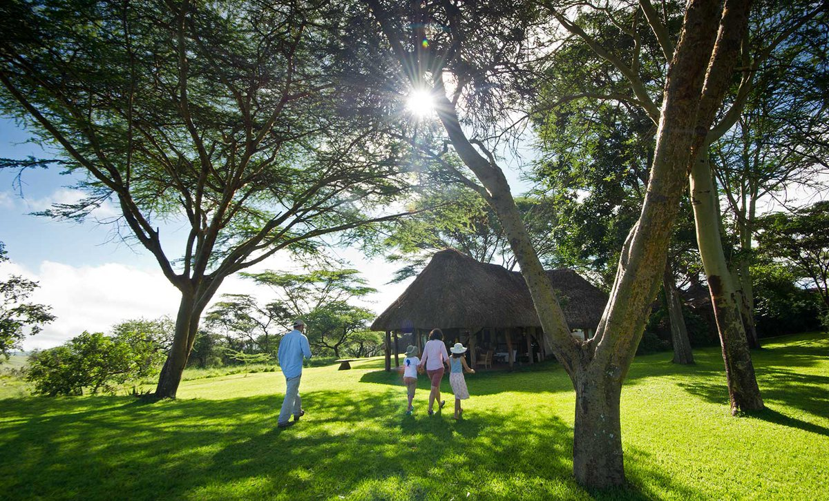 Family walking across the lawn at Lewa House