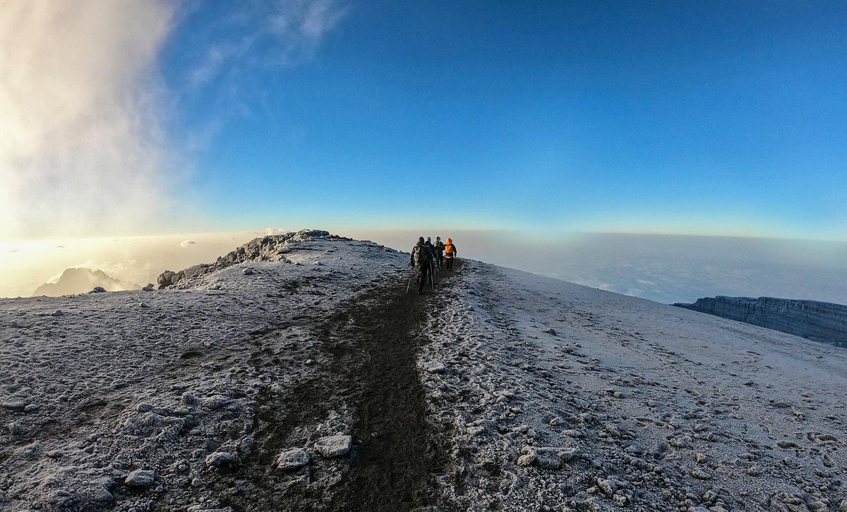 Hikers climbing Mount Meru