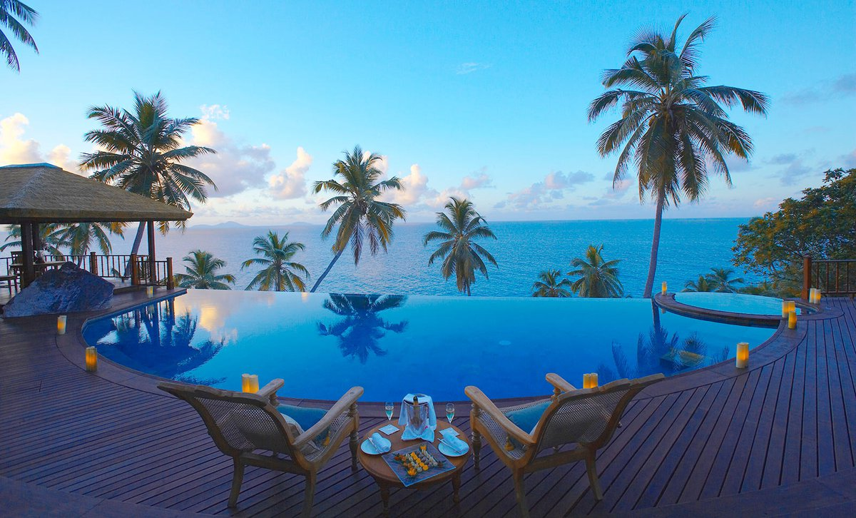 Infinity pool view over Indian Ocean at dusk on Fregate Private Island