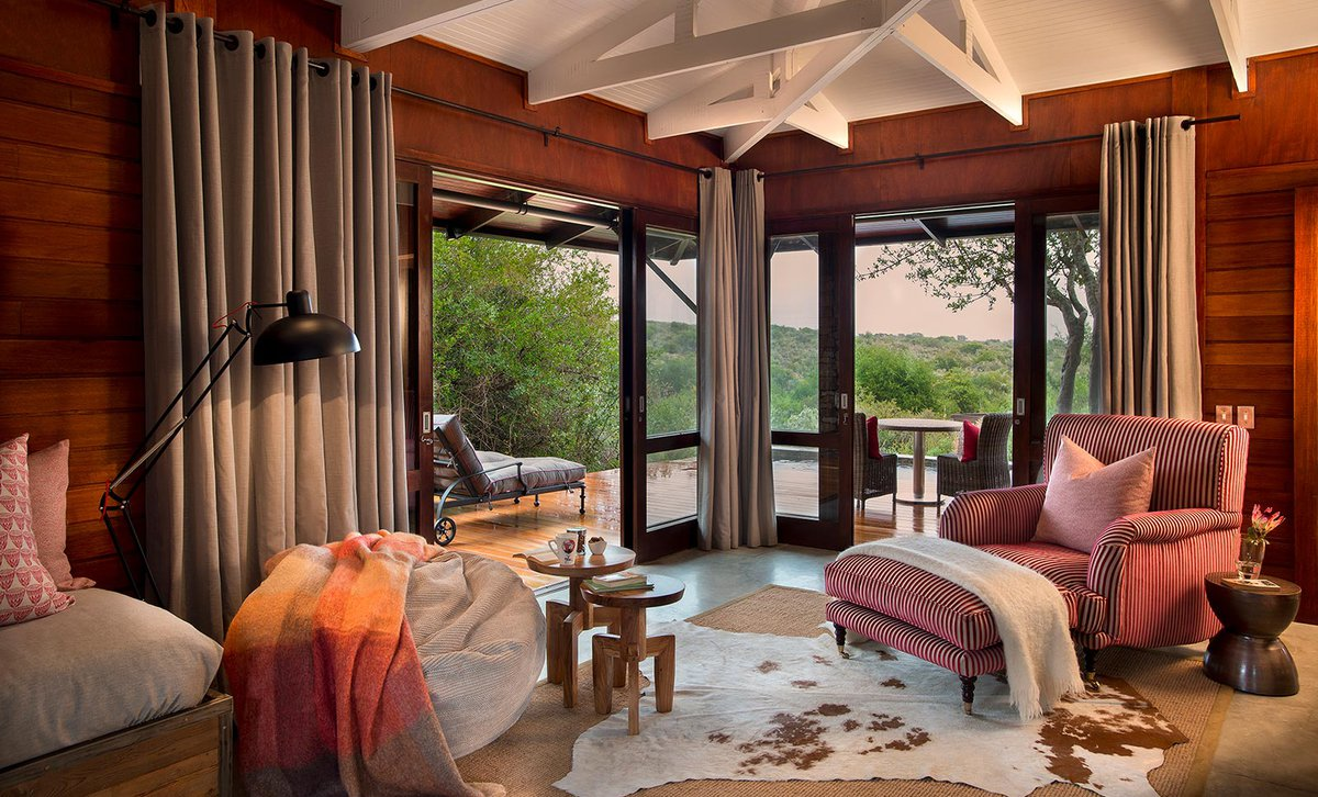 Kwandwe Ecca Lodge guest suite interior with view of reserve