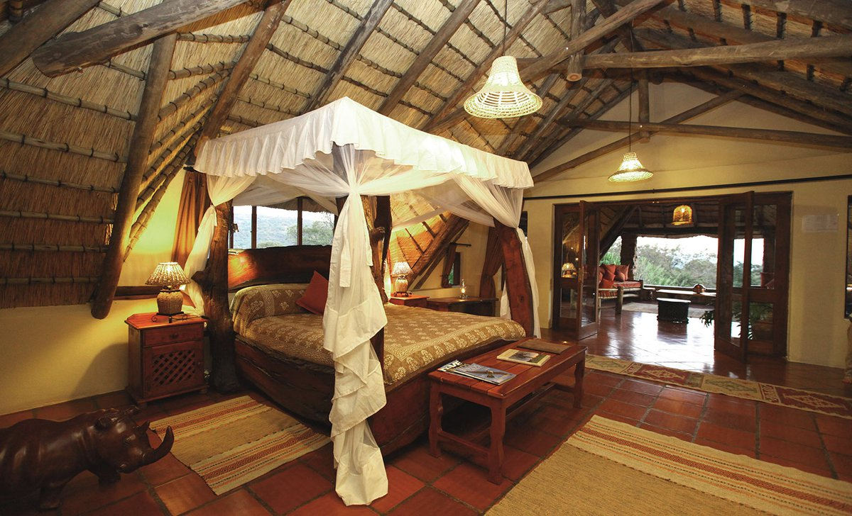 Interior of guest suite bedroom at Ant's Nest safari lodge in Waterberg