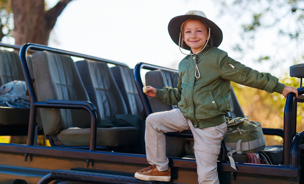 boy-game-drive-vehicle-smiling-south-africa-family-safari-67724.jpg