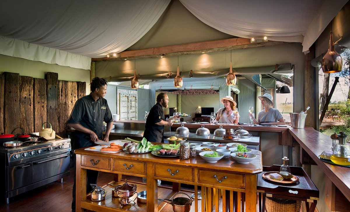 Guests in the Duba Plains kitchen with chefs