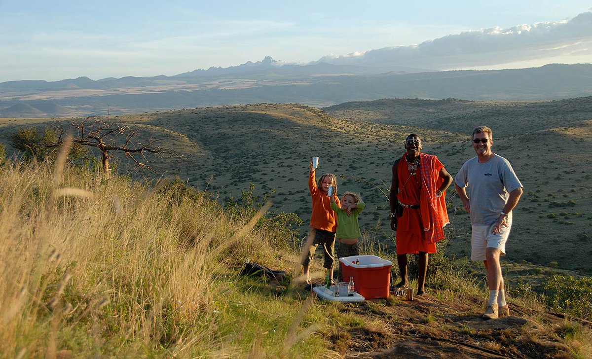 safari sundowners with children in lewa conservancy kenya