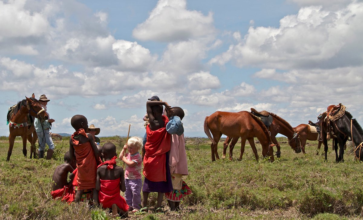 Children with Samburu after horseback safari at Ol Malo