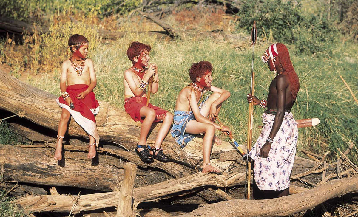 children with Maasai warrior