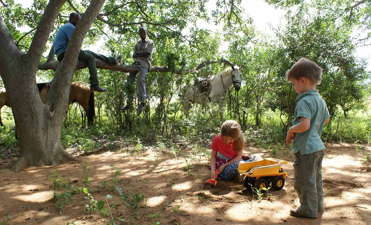 Kids playing and horse on safari Leobo Lodge
