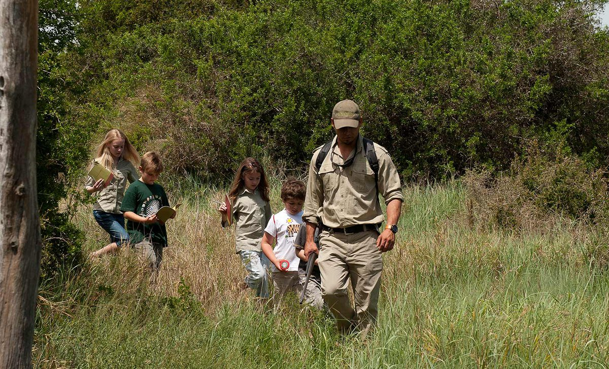 Kids on walking safari with expert guide in South Africa