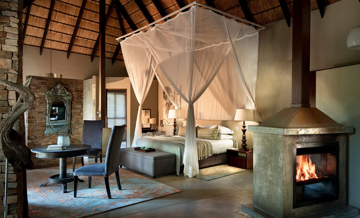 Four poster bed draped with netting in guest suite at Chitwa Chitwa