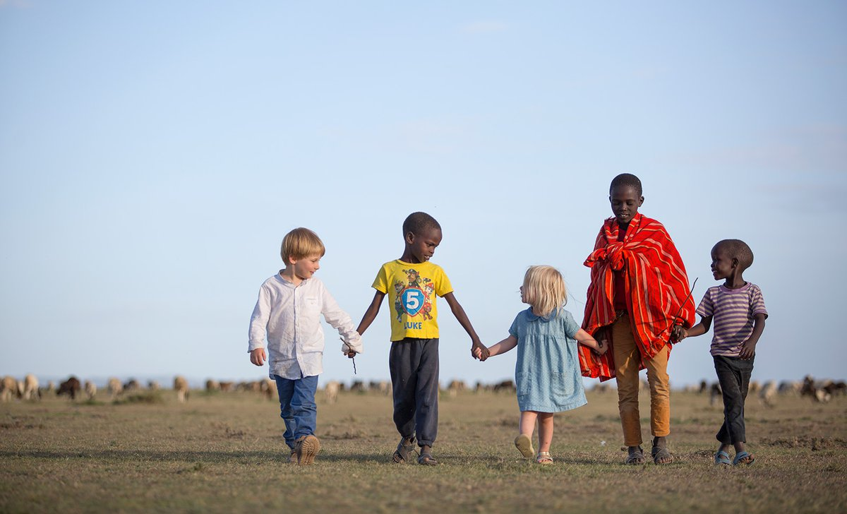 Children on safari walking with Maasai children