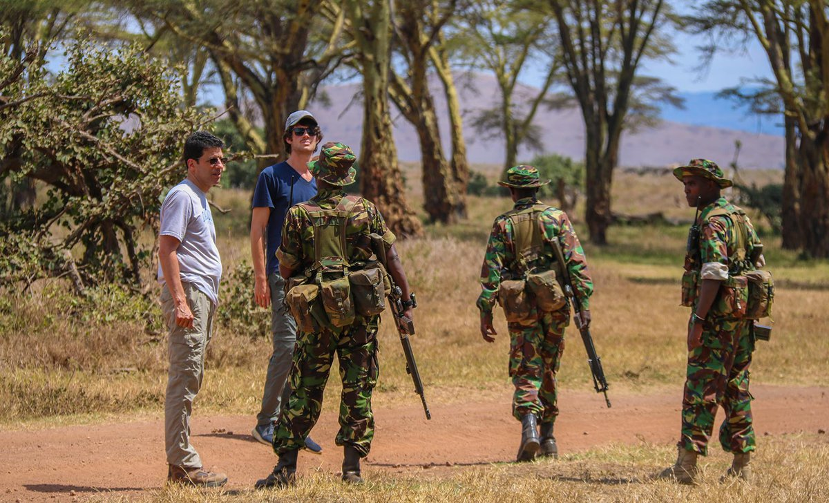Dad and teenage son with anti-poaching rangers in Lewa