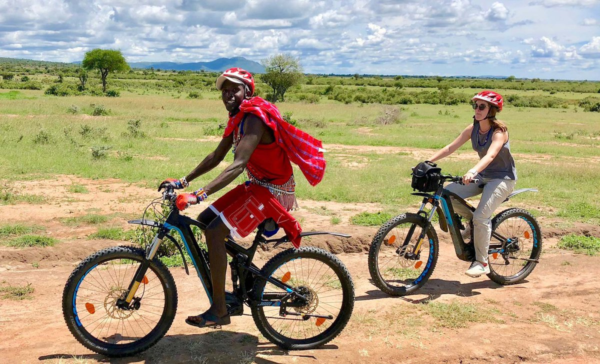 Girl riding with Maasai in Kenya