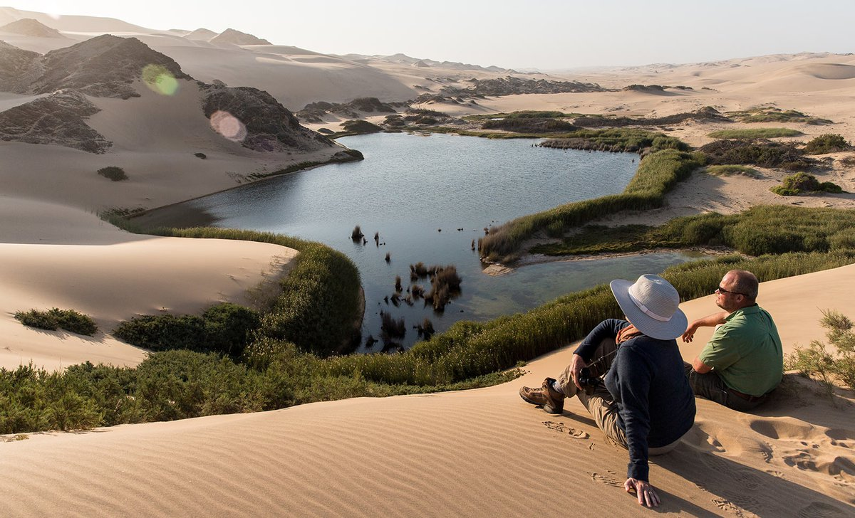 Guests overlooking lake on namibia's skeleton coast