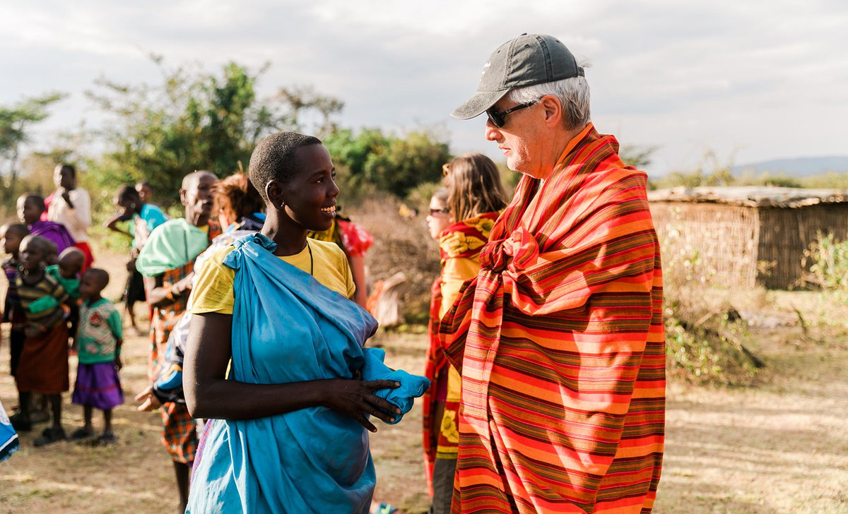 Dad speaking to Maasai woman on safari stay at Cottar's Private House