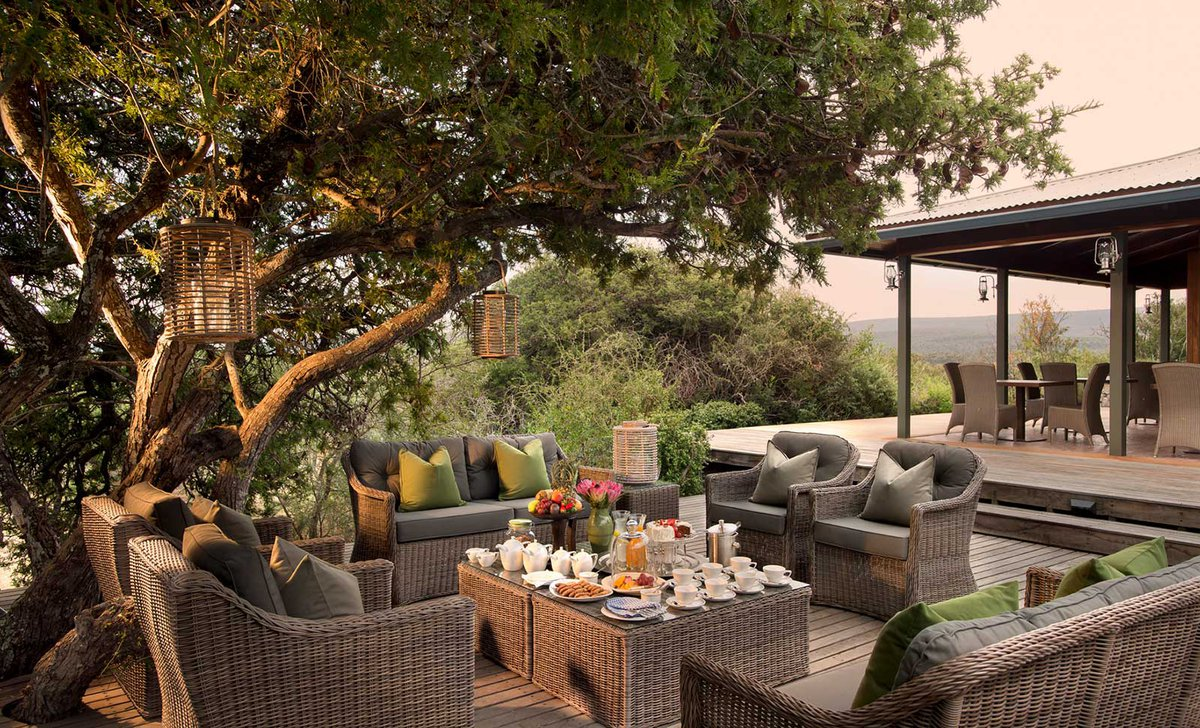 Exterior dining deck set for breakfast at Kwandwe Ecca Lodge