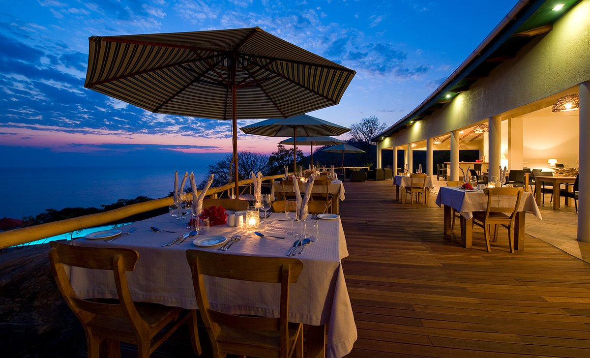 Deck dining in evening at Pumulani Lodge