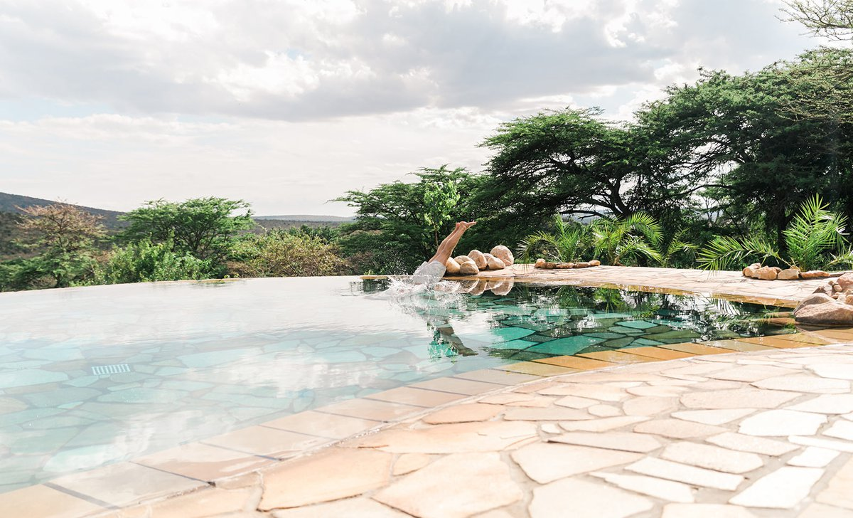 Diving into the pool at Cottars