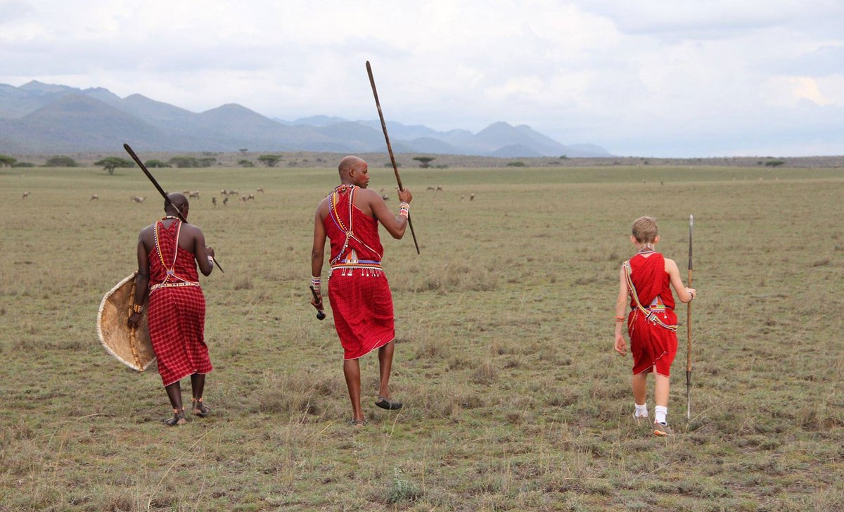 Child with Maasai warriors