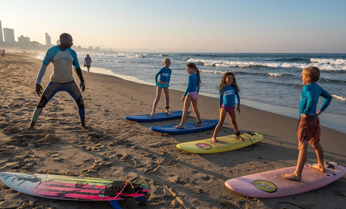 Children learning to surf in KwaZulu Natal