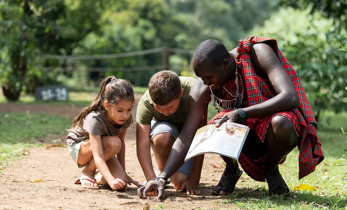 Children tracking with Maasai guide