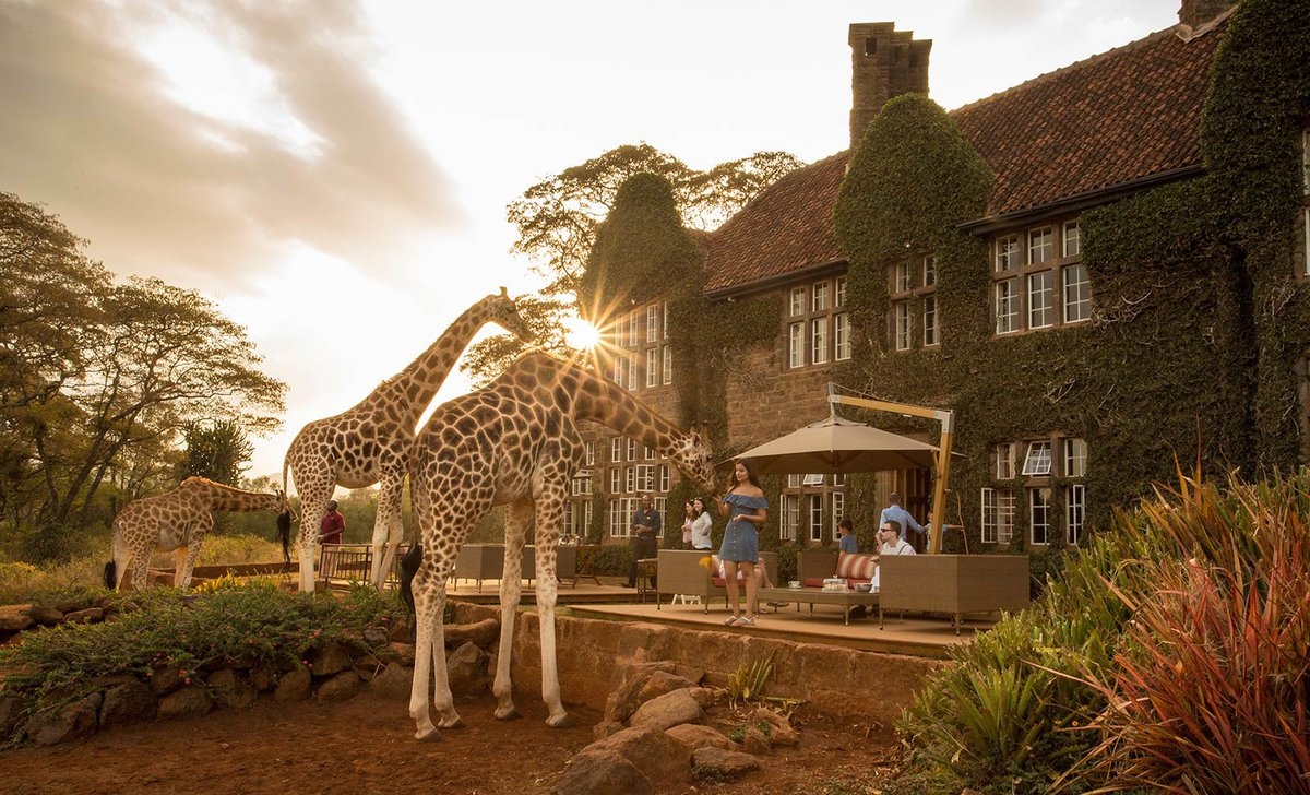 Giraffe Manor exterior with guests