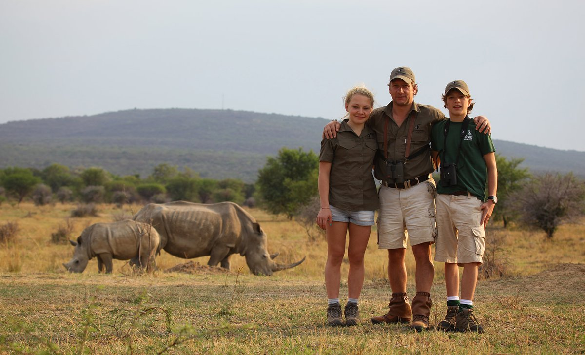 Family guides near rhino and calf at Ant's Nest