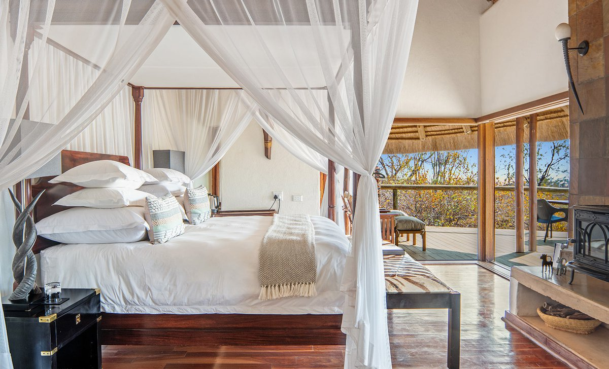 Royal Madikwe's Honeymoon Suite bedroom with canopy bed and private deck