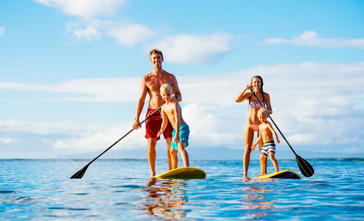 Family on stand up paddle boards off Kenya's coast
