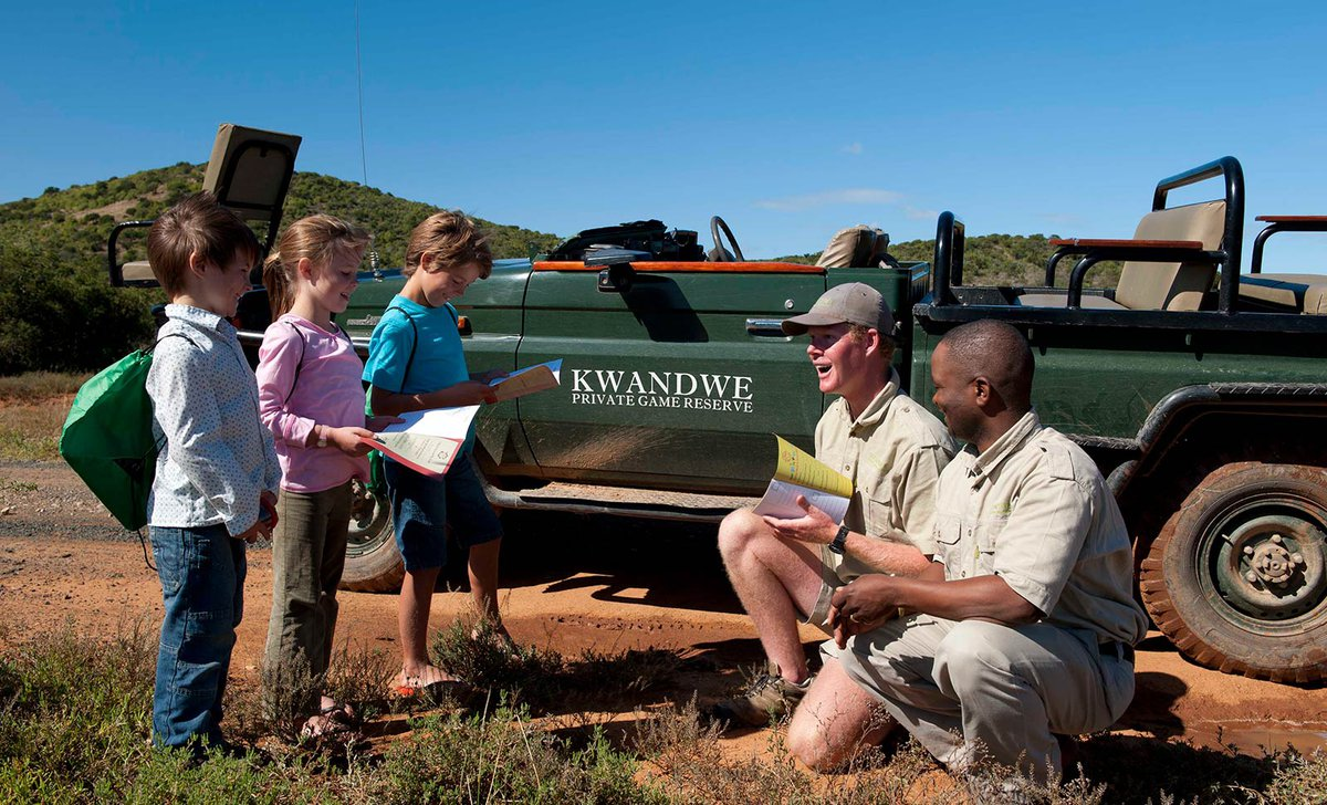 Kids and guides game drive stop on safari in South Africa