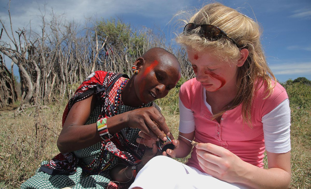 Girl learning beading with Maasai