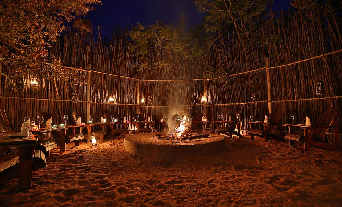 Communal firepit at night at Leobo Lodge