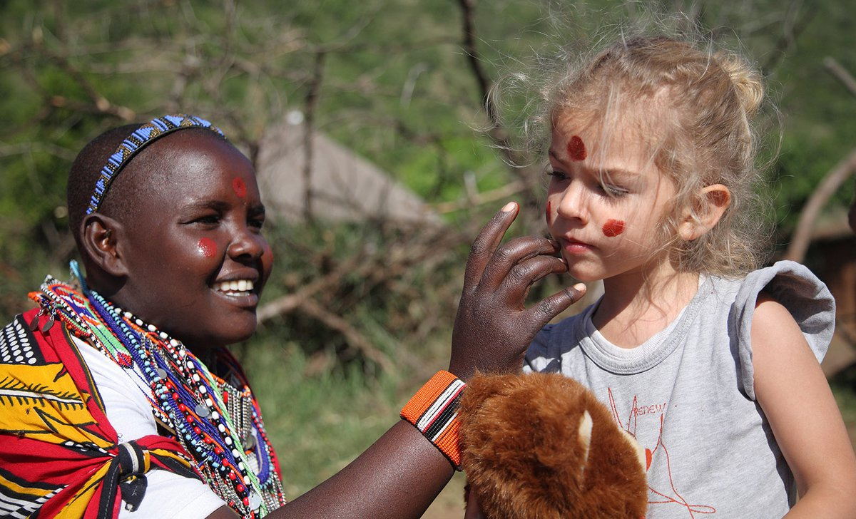Maasai face painting child on safari
