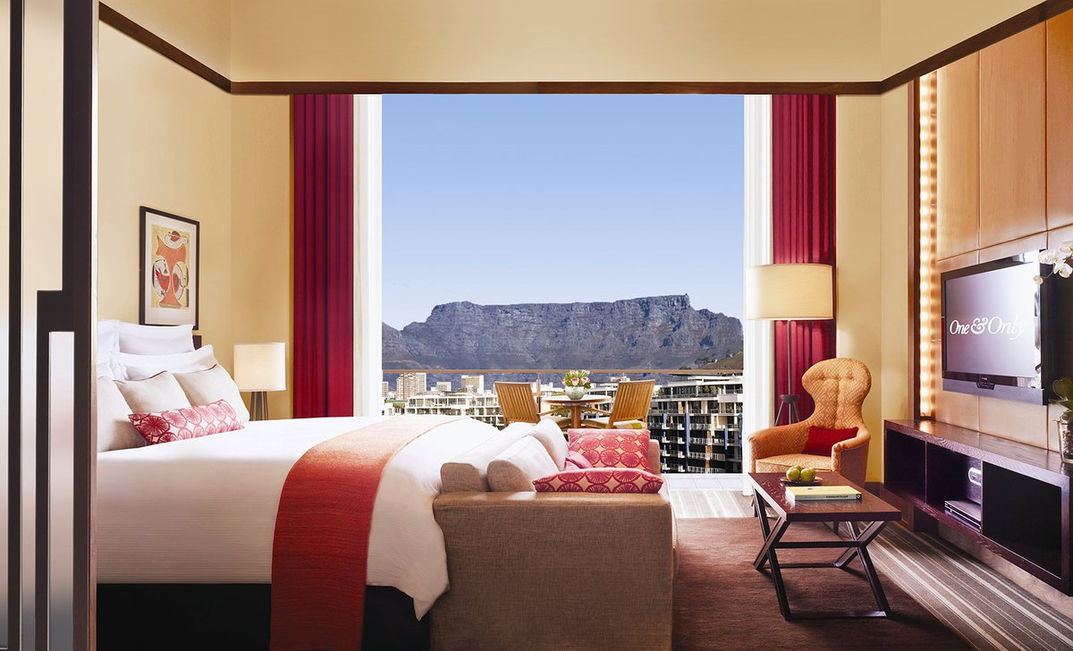 bedroom open to balcony overlooking table mountain
