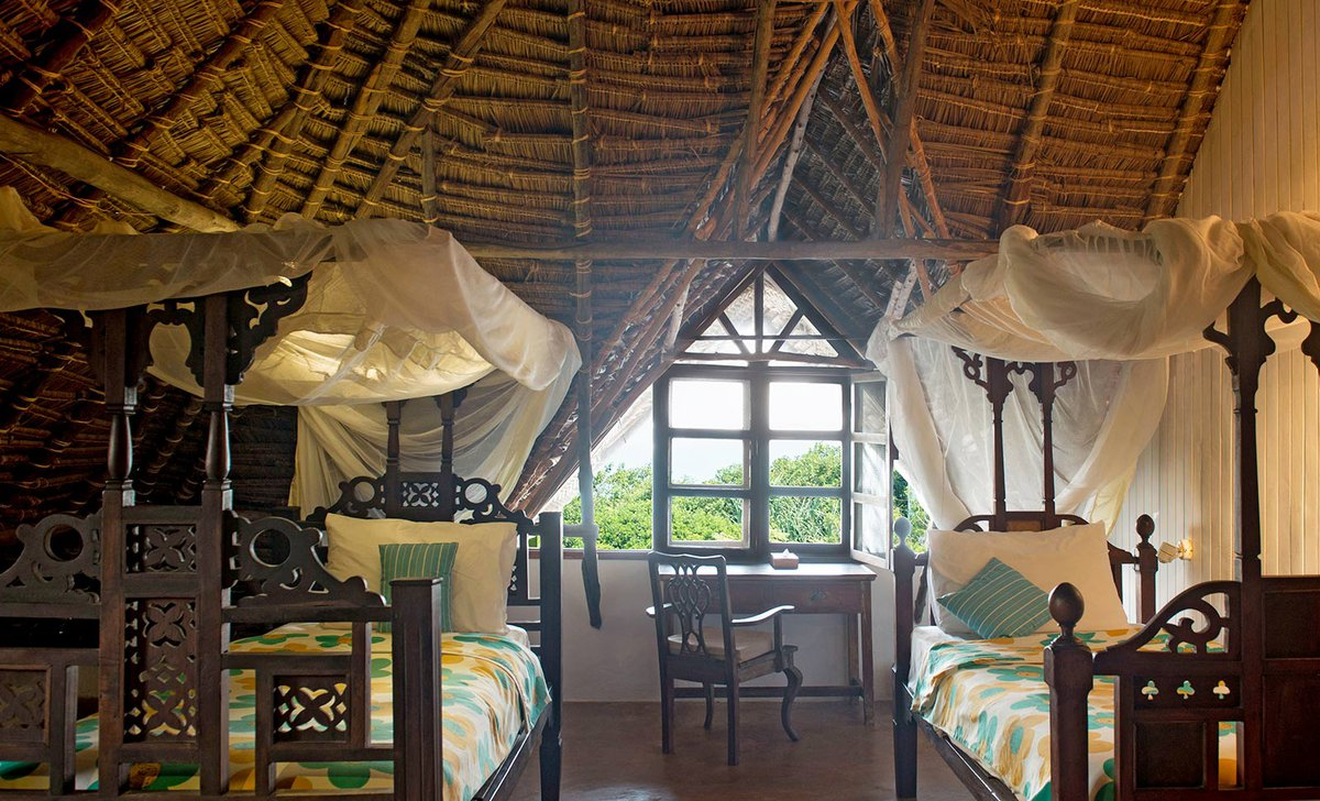 Twin bedroom at Matemwe Beach House
