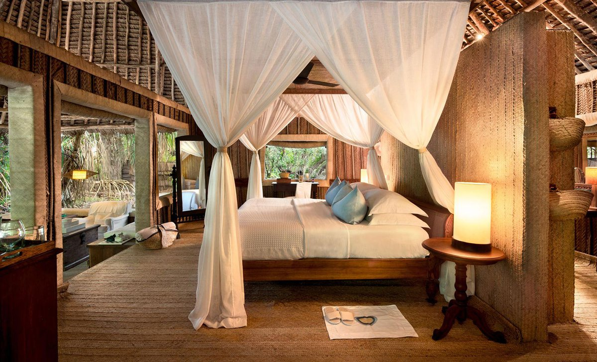 Interior bedroom furnishings at Mnemba Private Island resort