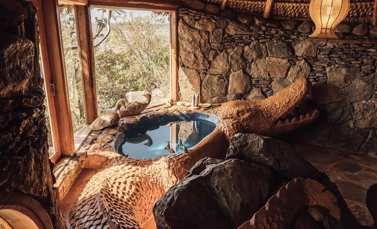Ol Malo House carved crocodile bathtub built into rock architecture
