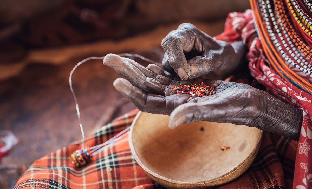 Samburu woman beading traditional colourful tribal crafts