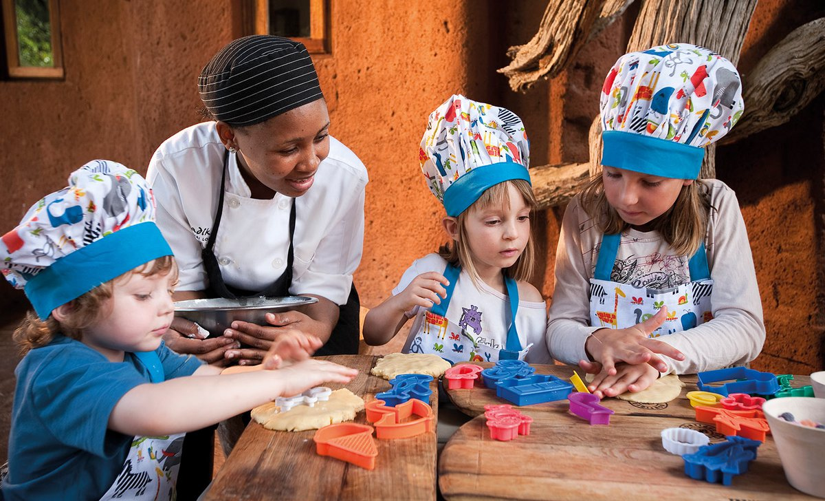 Kids making treats with staff at Madikwe Safari Lodge