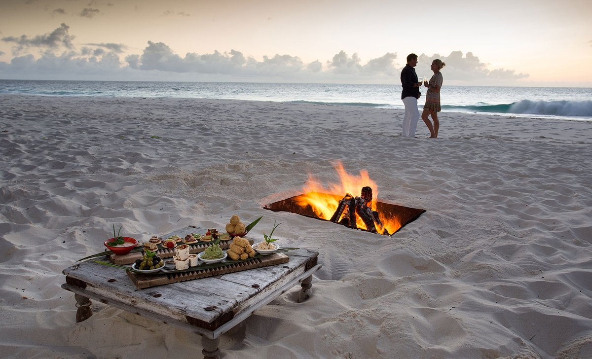 Private dinner on the beach at North Island, Seychelles.