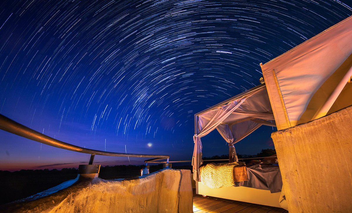 Startrails over outdoor bed at Puku Ridge