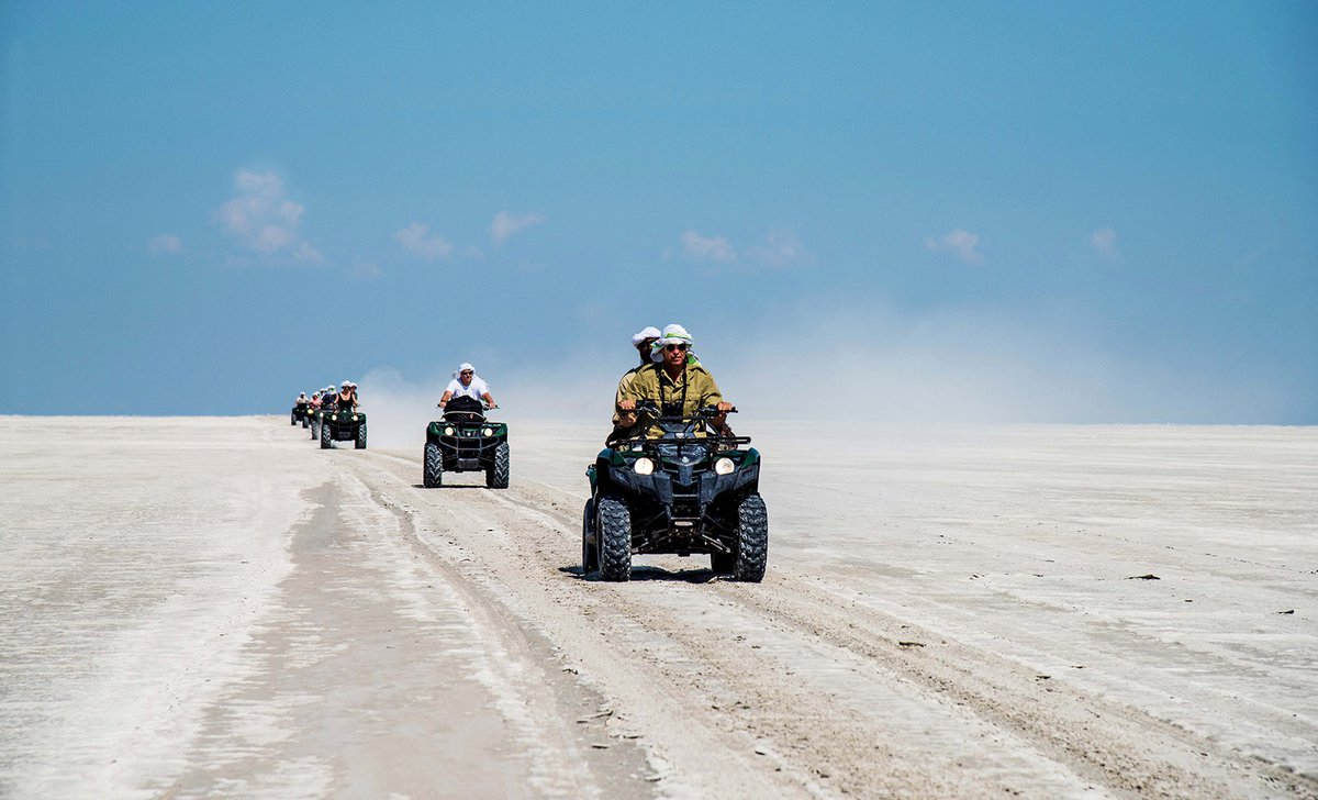 Group quadbiking over Makgadikgadi Pans