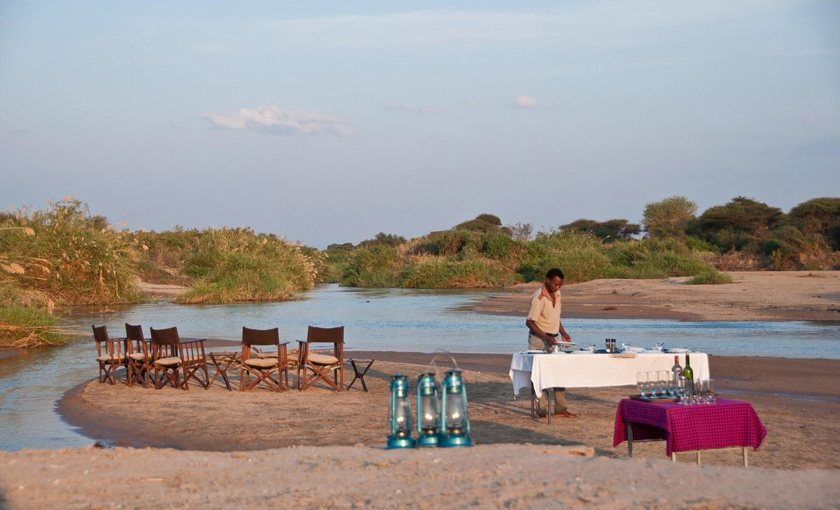 Riverside dining setup at Kichaka Camp