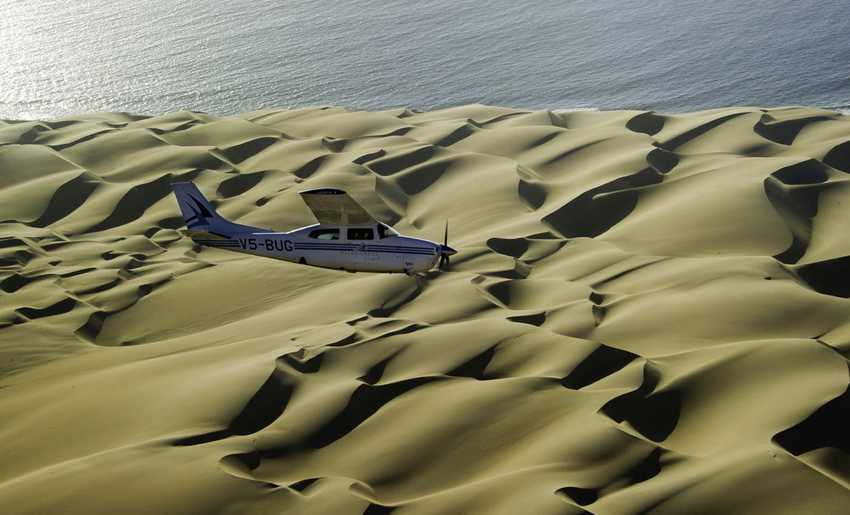 Light aircraft flight over skeleton coast dunes